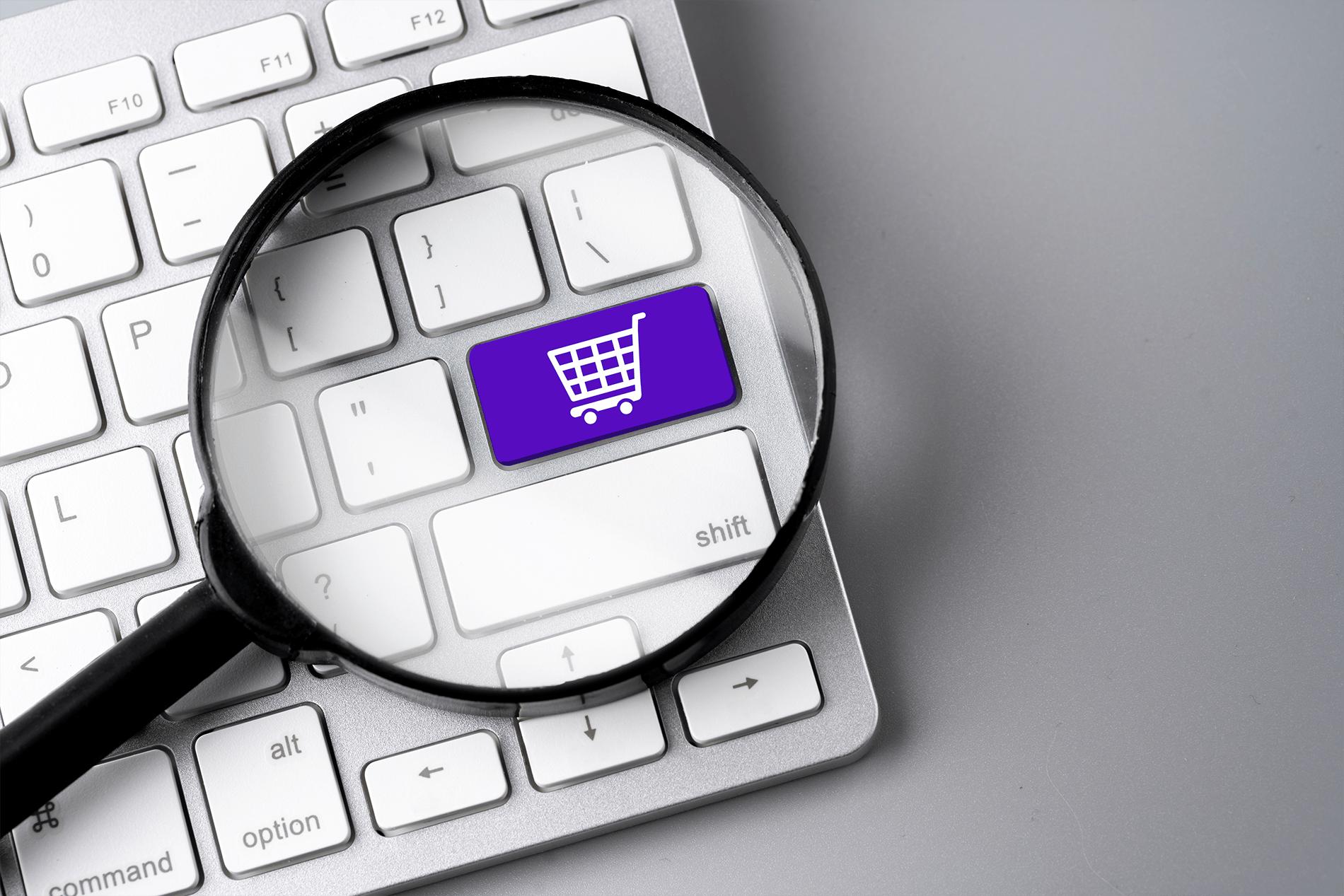 teclado de ordenador con botón de shopping
